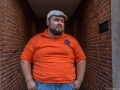 large guy orange shirt.jpg