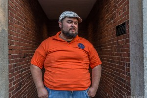 large-guy-orange-shirt